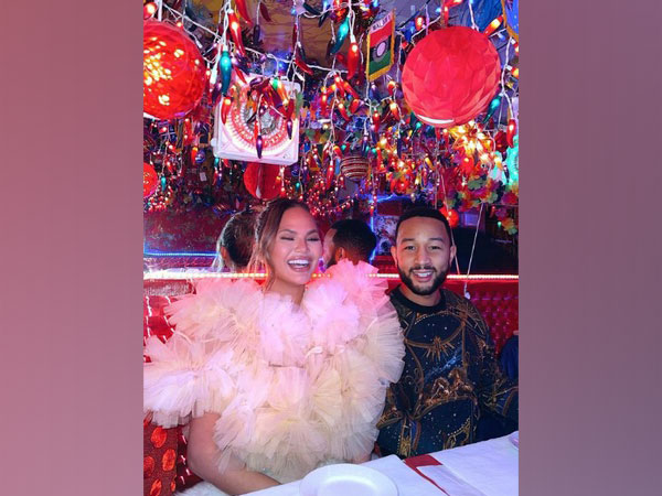 Chrissy Teigen with husband and singer John Legend (Image Source: Instagram)