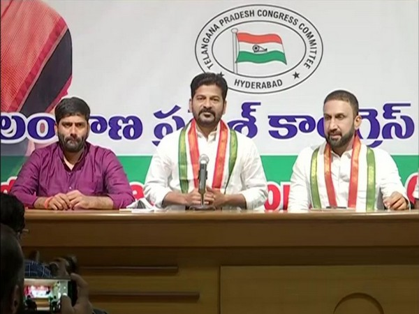 Congress MP Revanth Reddy (Centre) during press conference (Photo/ANI)