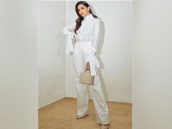 Deepika Padukone is a vision in white posing for the camera