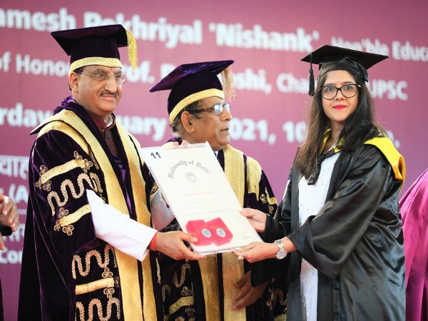 Union Education Minister Ramesh Pokhriyal Nishank awarding degree to a  DU student during annual convocation on Saturday. (Picture source: Twitter/Dr Ramesh Ramesh Pokhriyal Nishank)