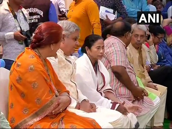 Governor Jagdeep Dhankar and CM Mamata  Banerjee during a puja in Kolkata on Sunday. Photo/ANI