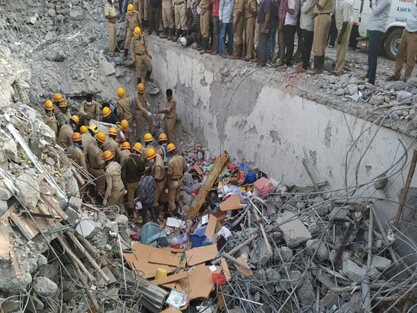 Rescue operation underway at building collapse site in Dharwad, Karnataka, on Friday.