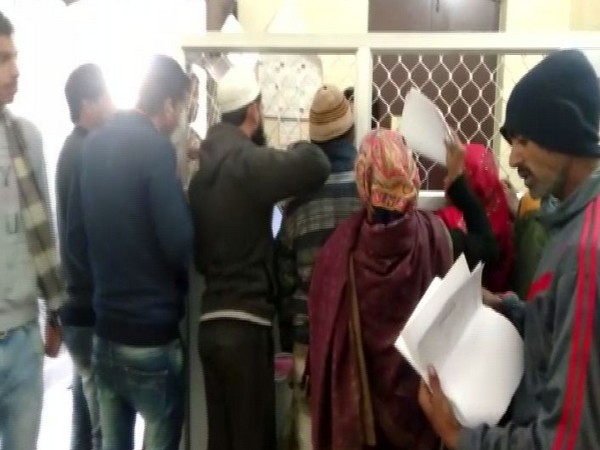 People waiting at the counter of the Hapur Municipal Corporation in Uttar Pradesh on Wednesday to receive their birth certificates. Photo/ANI