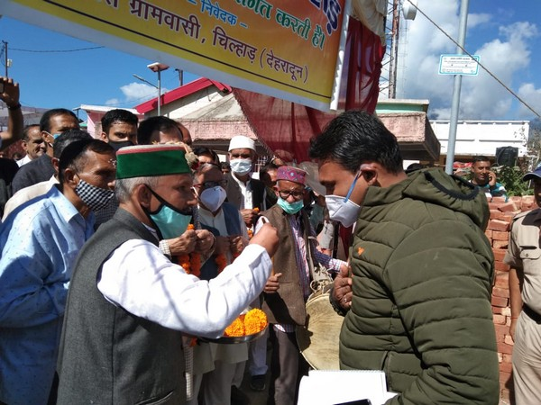 Dehradun District Magistrate received a warm welcome from the villagers. (Photo/ANI)