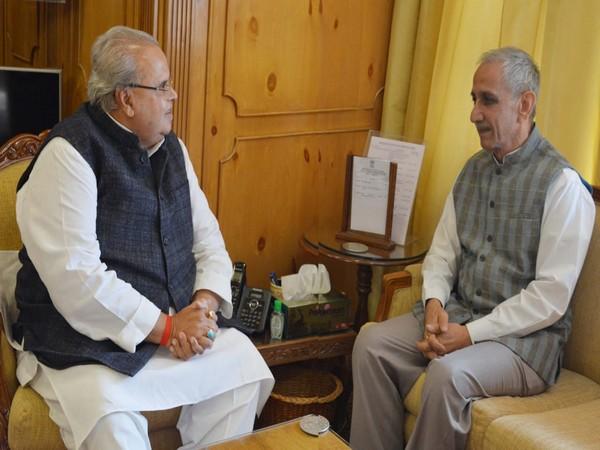 Dineshwar Sharma (right) meeting Jammu and Kashmir Governor Satya Pal Malik (left)