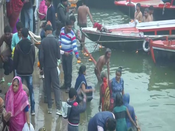 Devotees taking a dip in Ganga in Varanasi. Photo/ANI