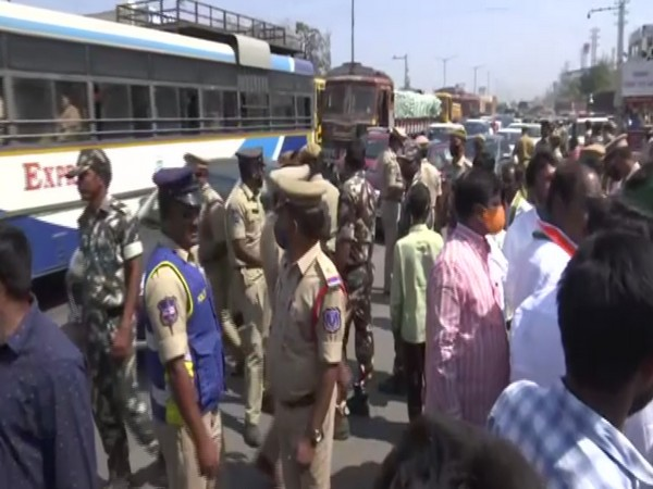 Police removing protestors from Highway in Hyderabad.