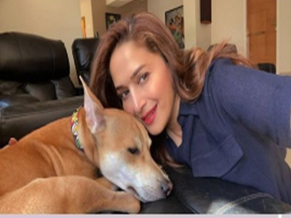 Actor Madhuri Dixit with her pet dog (Image Source: Instagram)