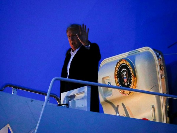 US President Donald Trump waves after returning to Washington DC on Wednesday morning (local time).