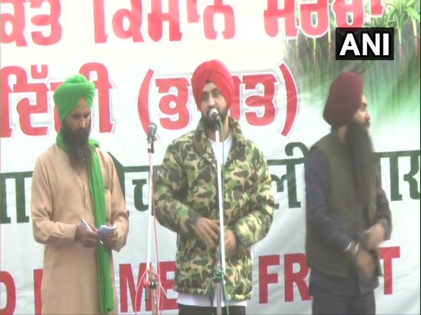 Singer and actor Diljit Singh Dosanjh addressing farmers at Singh Border. (Photo/ANI)