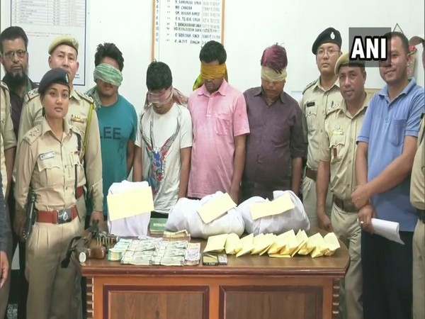 Visuals of accused with seized drug and cash in Thoubal, Manipur.