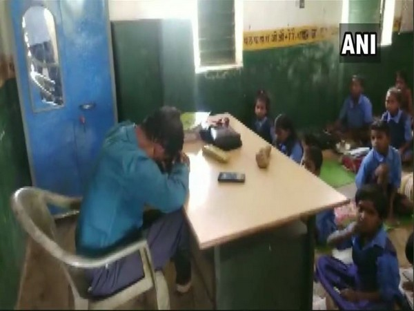 Ajaydan Minj seen sleeping in the classroom in the viral video. Photo/ANI