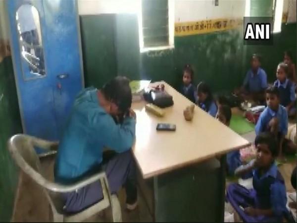 Ajaydan Minj seen sleeping in the classroom in the viral video. Photo/ANI