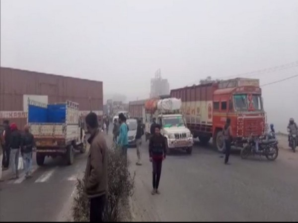 RJD workers blocked the National Highway 28 in Muzaffarpur (Photo/ANI)