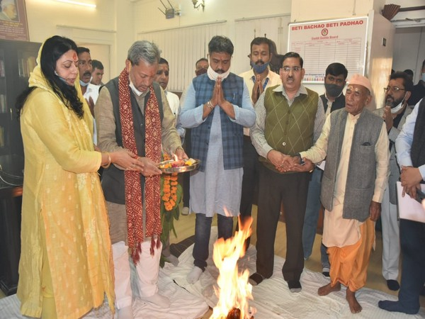 Uttarakhand CM Tirath Singh Rawat performing a puja in his office on Sunday.
