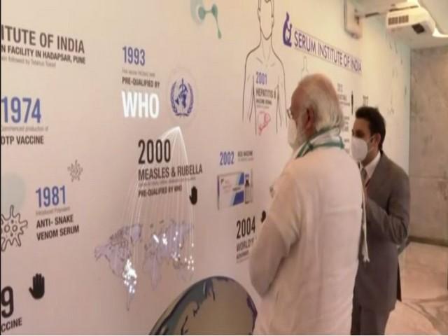 PM Narendra Modi with Serum Institute of India, CEO, Adar Poonawalla (photo/ANI)