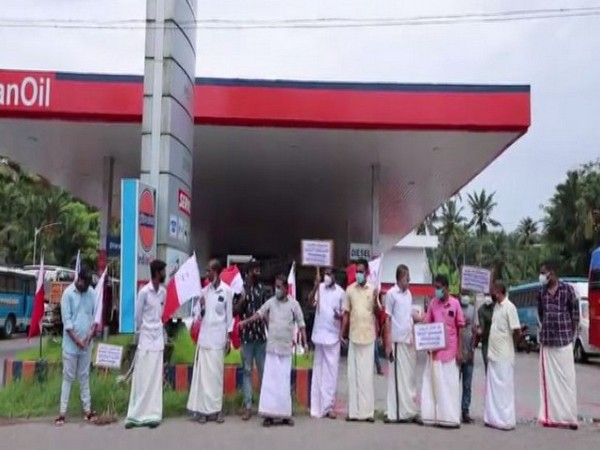 Protest held by Kerala Congress (M) workers at petrol pump in Ayoor, Kollam. (Photo/ANI)