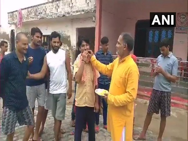Shivali villagers distribute sweets after Vikas Dubey dies in police encounter. (Photo/ANI)