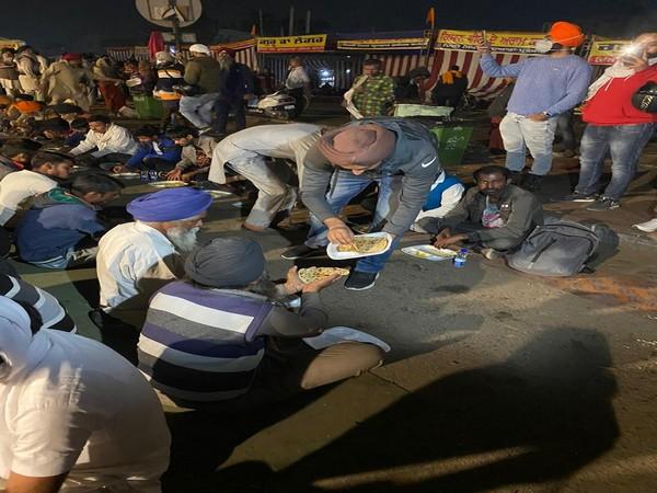 DU Students serving 'Langar' to farmers at Singhu border. (Photo/ANI)