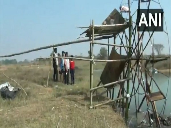 The water irrigation system made out of bamboo and plastic water bottles. (Photo/ANI)