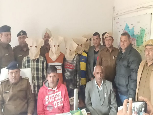 Haryana police with five accused on Tuesday. Photo/ANI