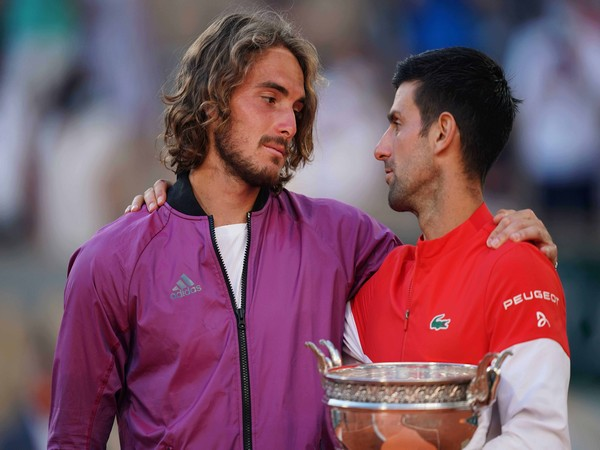 Stefanos Tsitsipas and Novak Djokovic after the Roland Garros Final. (Photo: Nicolas Gouhier/FFT)