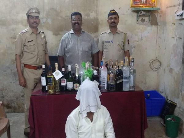 EC officials with seized liquor.