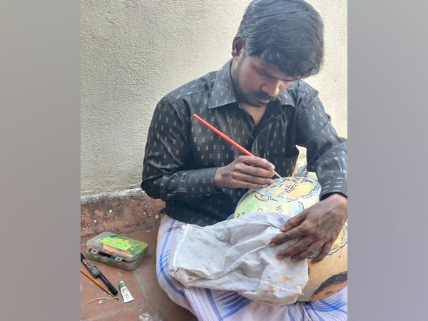 Chennai based artist Joel Fertician made COVID-19 related drawing on the clay pots [Photo/ANI]