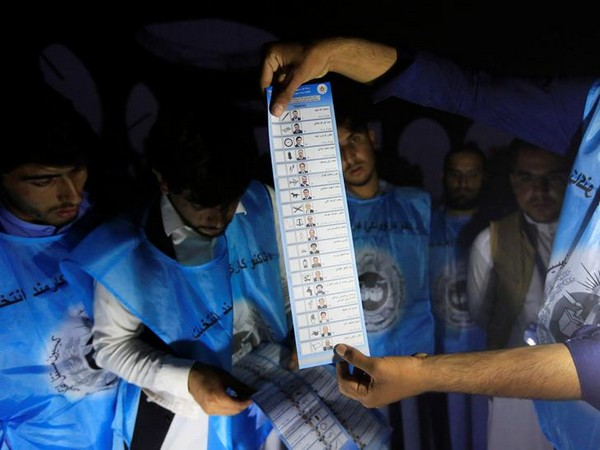 Afghan election commission workers count ballot papers of the presidential election in Jalalabad