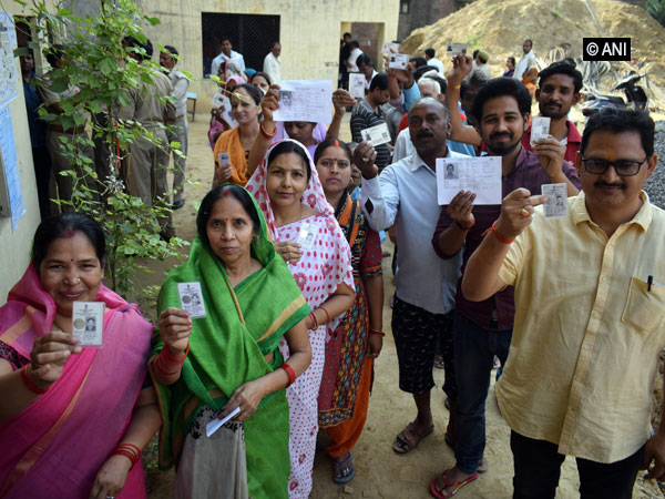 Voters waiting for their turn at a polling booth in Uttar Pradesh on Sunday. (Photo/ANI)