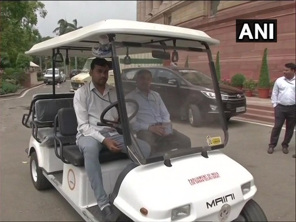 Electric gold cart ferrying people inside parliament premises in New Delhi (photo/ANI)