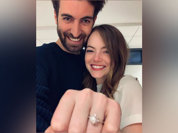 Emma Stone and Dave McCary posing with the engagement ring (Source: Dave McCary's Instagram)