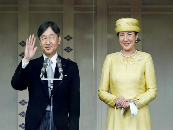 Emperor Naruhito and Empress Masako greet well-wishers during their first public appearance at the Imperial Palace in Tokyo in May. (File photo)