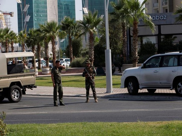 Kurdish security personnel near a restaurant in Erbil where a Turkish diplomat was killed on Wednesday.