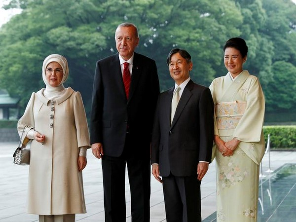 Turkish President Tayyip Erdogan and his wife Emine are welcomed by Japan's Emperor Naruhito and Empress Masako.