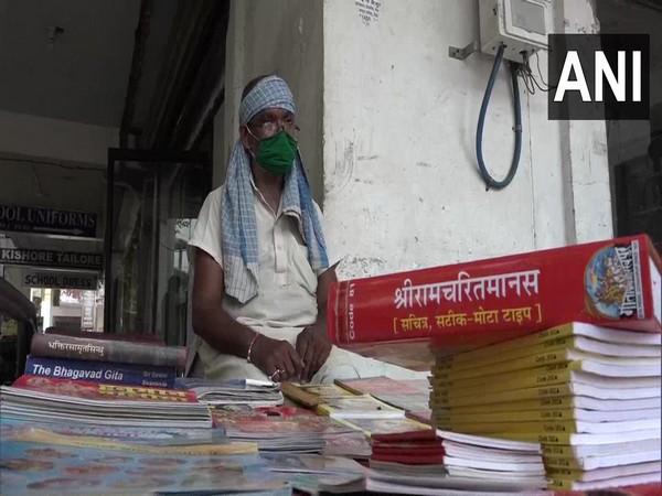 53-year-old Buddhi Sagar Pandey at his book stall in Agra. (Photo/ANI)