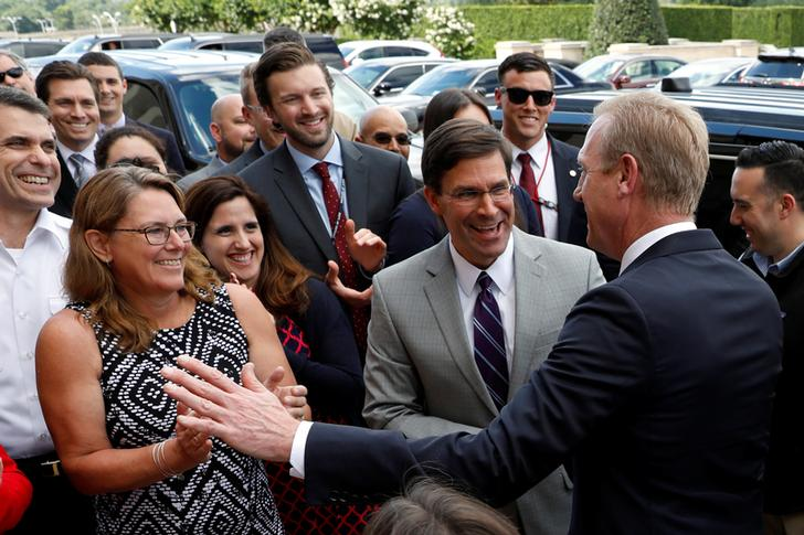 Outgoing US Acting Defence Secretary Patrick Shanahan (R) with his successor Mark Esper (L) in Washington on June 21 (Photo/Reuters)