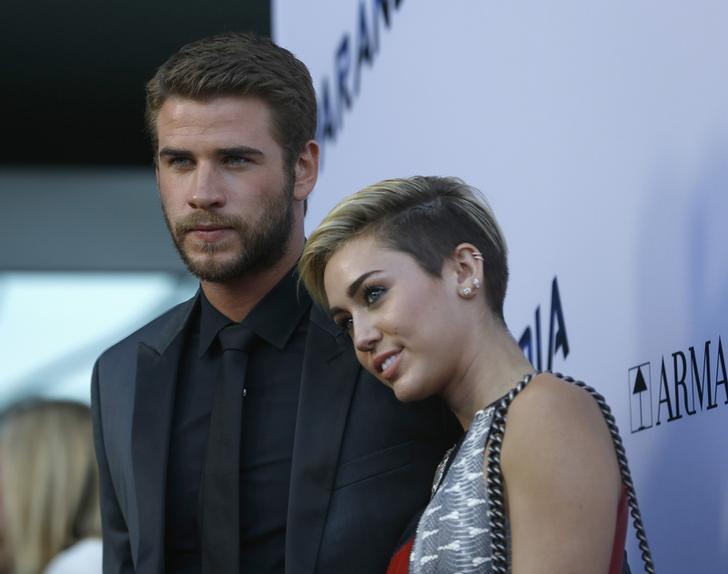 Miley Cyrus?and Liam Hemsworth