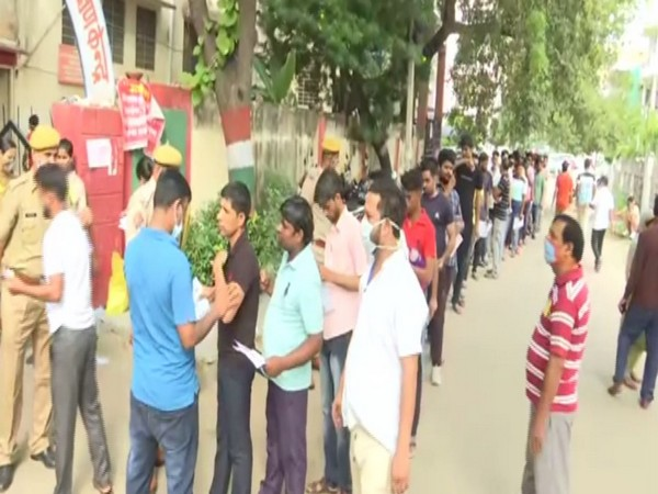 Students standing outside an examination centre in Jaipur (Photo/ANI)