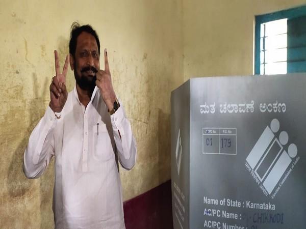 Karnataka Deputy Chief Minister Laxman Savadi at a polling booth in Athani constituency [Photo/ANI]