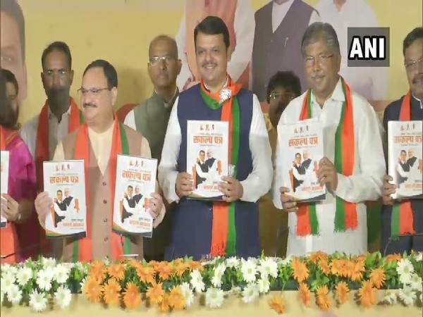 Maharashtra Chief Minister Devendra Fadnavis and BJP Working President JP Nadda releasing the party's election manifesto in Mumbai on Tuesday. (Photo/ANI)