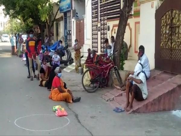 People at a fair price shop in Mangalagiri in Andhra Pradesh. Photo/ANI