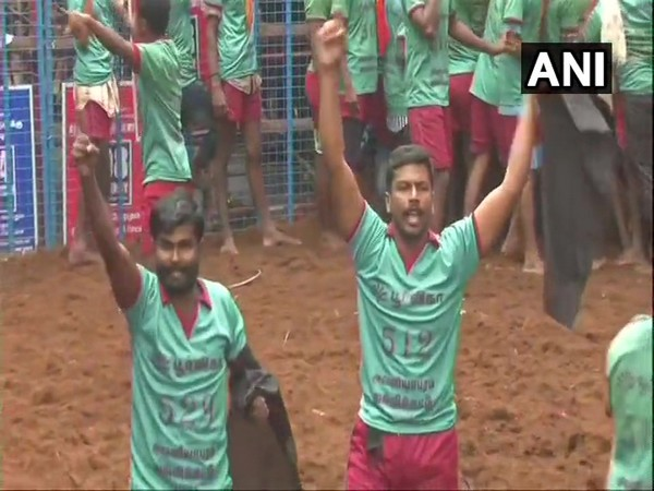 Bull tamers who waived black flags and raised slogans against farm laws during Jallikattu event in Madurai on Thursday. (Photo/ANI)