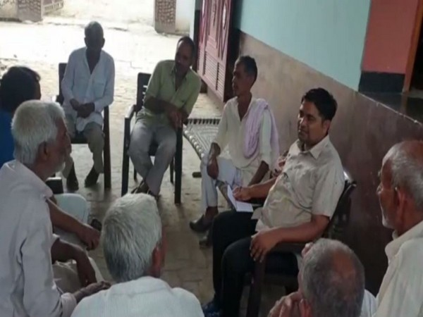 Villagers at the farmer's home in Hapur. Photo/ANI