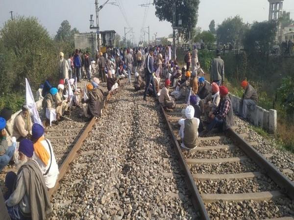 Farmers block railway tracks, demand clearance of sugarcane dues in Amritsar. Photo/ANI