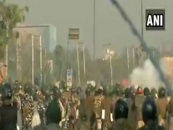 Amid the farmer's 'Delhi chalo' protest march, Police is used tear gas shells to disperse protesting farmers at the Singhu border (Haryana-Delhi border) on Friday.