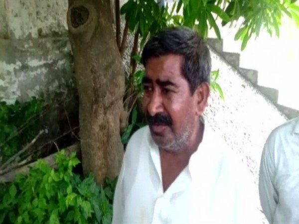 Nandkishore, brother of Devender speaking to reporters in Fatehpur, Uttar Pradesh on Sunday.
