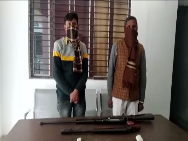 The arrested father-son duo at police station in Rampur. (Photo/ANI)