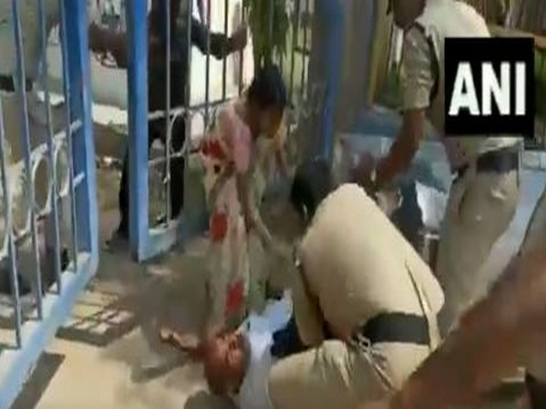 Father of a girl who committed suicide kicked by police personnel in Sanga Reddy district. Photo/ANI