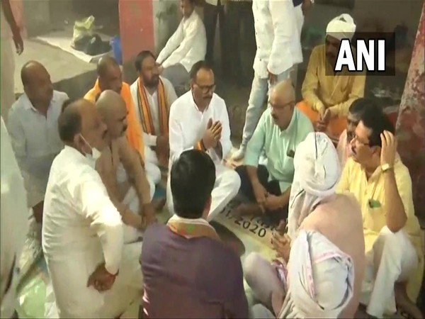 UP Law Minister Brajesh Pathak meeting the families of BJP worker Shubham Mishra and car driver Hari Om (Photo/ANI)
